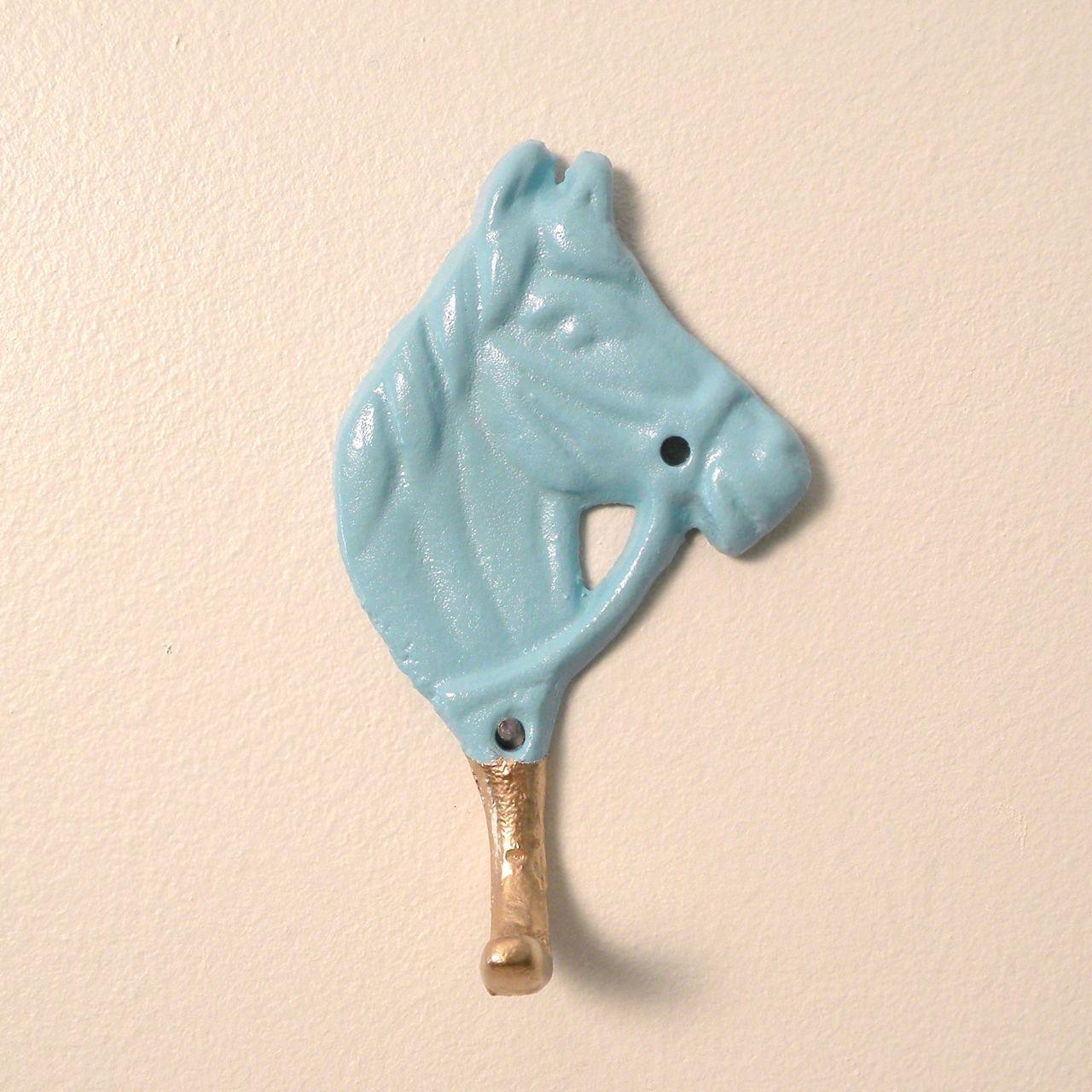 little cast iron horse hook. $10.00, via Etsy.