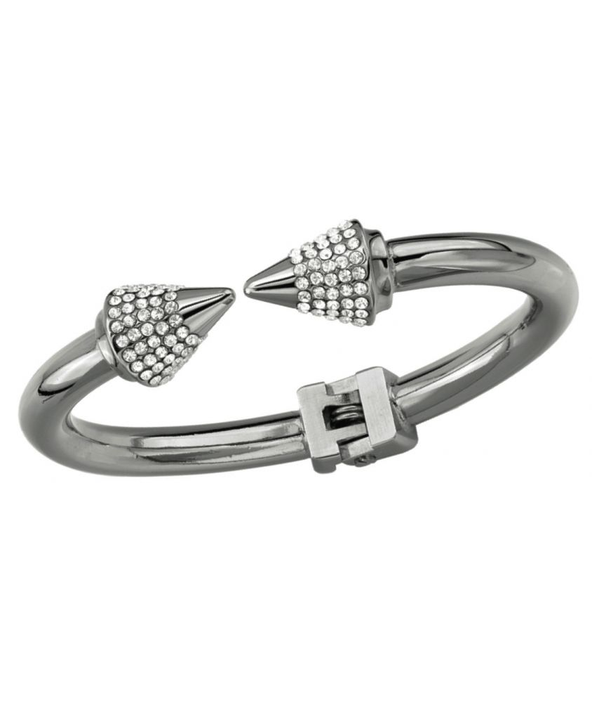 """Titan Crystal Bracelet        This Silver Gunmetal-plated bracelet features a swarovski cone detail with hindge closure.    * One size.  * 6 1/2"""" (3.5 cm) wide.  * Made in Italy.  ..."""