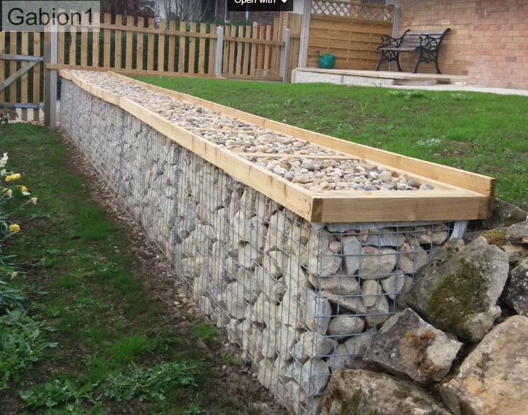 gabion wall with small pebble topping http://www.gabion1.co.uk