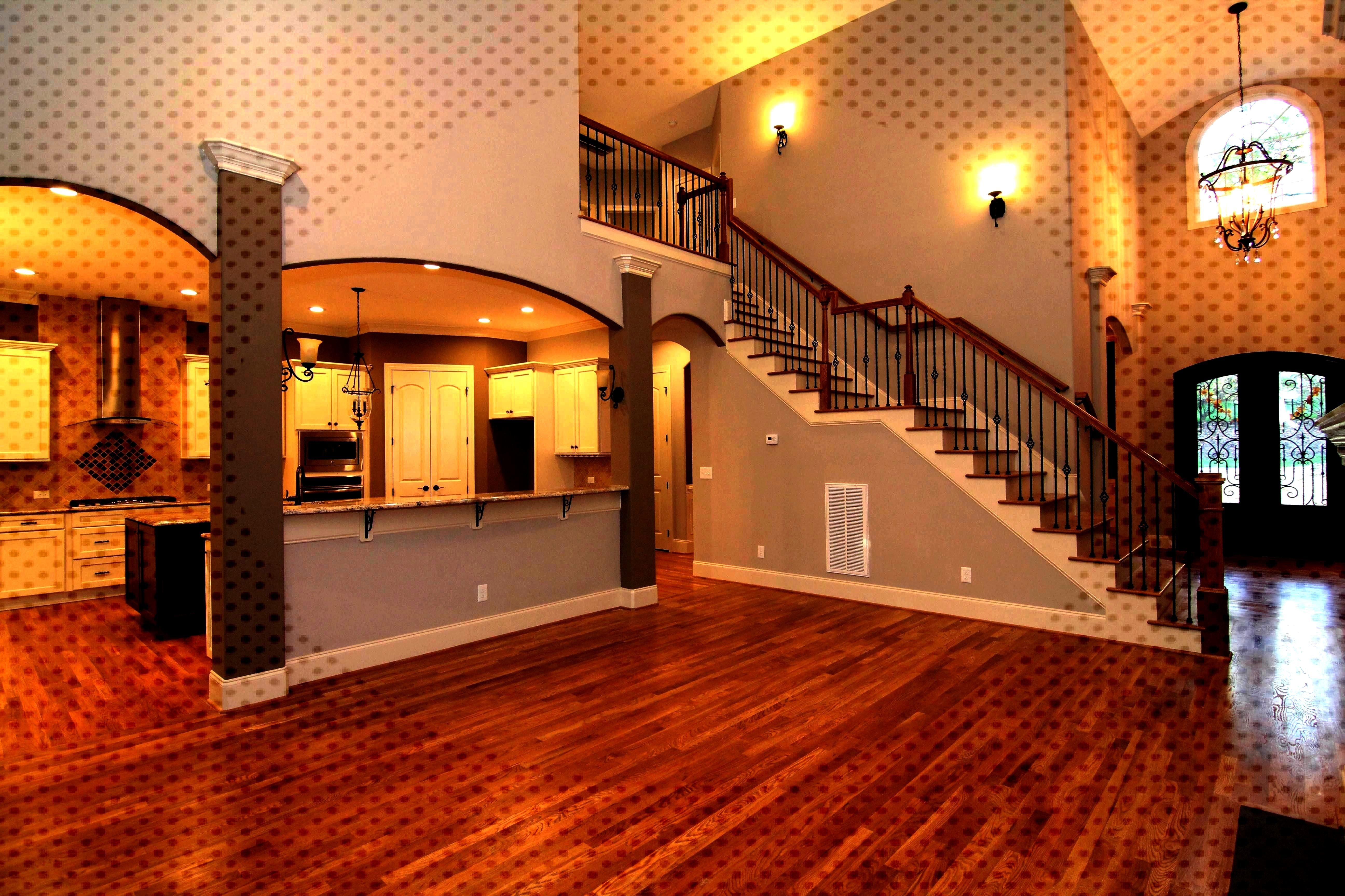 room open to the kitchen and barrel vault foyer Two story living room open to the kitchen and barr