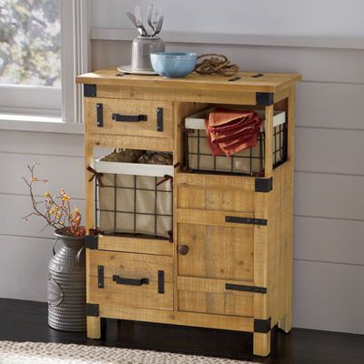 Rustic Cabinet Baskets Drawers And A Single Door Deliver Valuable Storage In Compact E