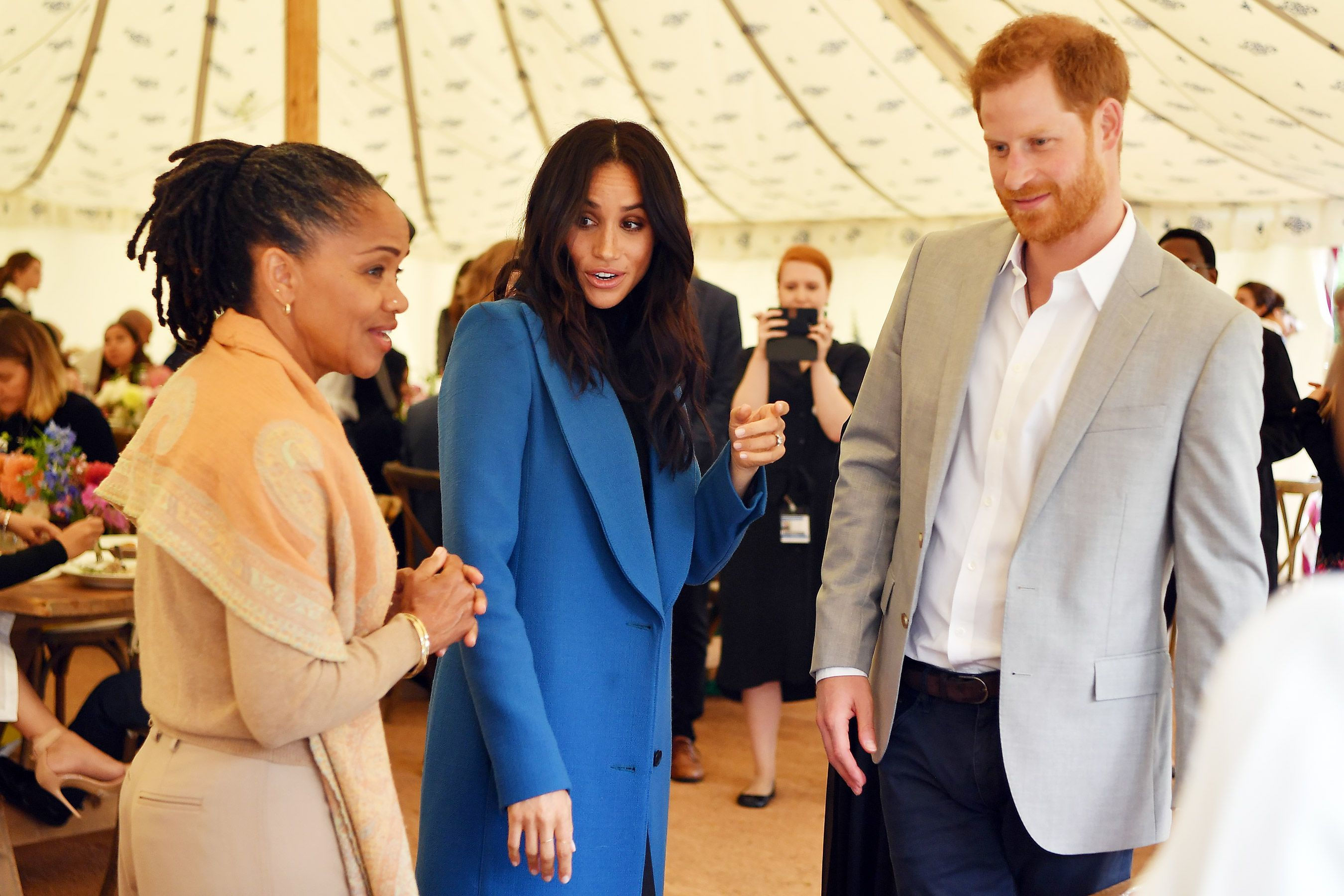 On Thursday, Duchess of Sussex Meghan Markle is joined by Prince Harry and her mother Doria Ragland at the launch of a cookbook written by a group of women affected by the Grenfell Tower fire at Kensington Palace.