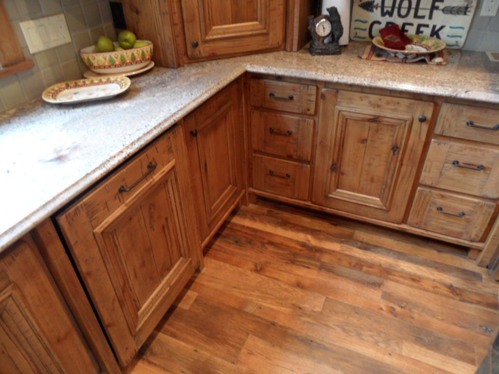Timberline Framers Inc, Pagosa Springs, Colorado. Overlay cabinets custom built and antiqued in kitchen.