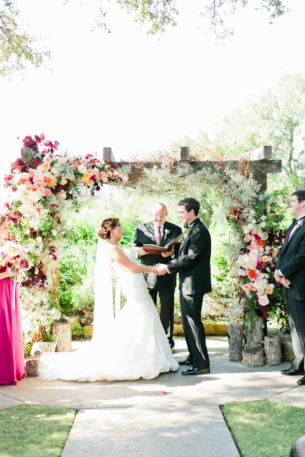 gorgeous baby's breath, air plant, and garden rose ceremony arch | Love, The Nelsons #wedding