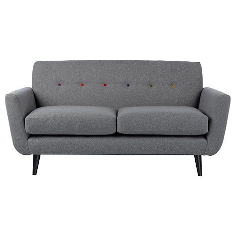 Our 'Hockney' range is designed by Ben de Lisi and combines classic, mid-century styling with a contemporary finish. This sofa features slim arms to maximise the seating space, while retro-inspired angled feet and quirky, multi-coloured button detailing are typical of the designer.