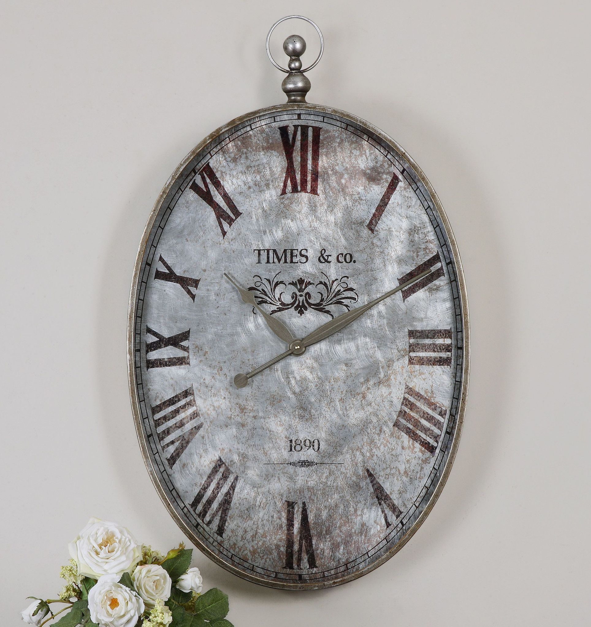 This Pocket Watch Themed Wall Clock Features A Brushed Aluminum
