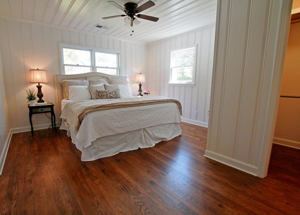 Prime Design Memphis Llc Master Bedroom Sherwin Williams Pure White Painted Knotty Pine Paneling Hardwood Floors Knotty Pine Walls Master Bedroom Bedroom