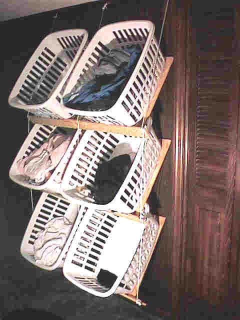 Lousy Pictures But Interesting Way To Hang Laundry Baskets