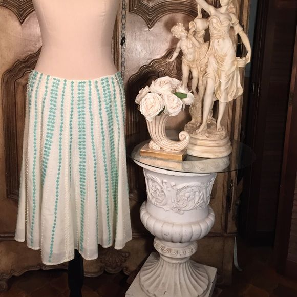 Nougat Lindon creme turquoise beaded full skirt What a feminine fantasy skirt by Nougat London . Full with a flirty hem. Fully lined cotton with elegant turquoise & creme colored beading. 24 inches long. Size 2 but runs more like a 4/6. Nougat London Skirts