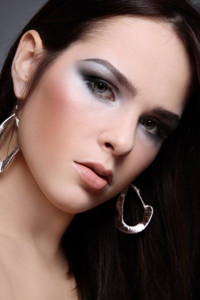 Silver make-up. Attractive brunette with elegant evening look