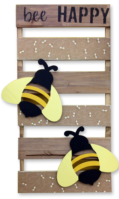 "DIY ""BEE HAPPY"" WOOD PALLET BOARD: Details: http://benfranklincraftsmonroe.blogspot.com/2016/03/diy-bee-happy-wood-pallet-board.html.   Here's what you'll need: • Wood Pallet Board: 12"" x 24"" • Pebbles Inc. Spring Fling Honey Bee Paper • Stencil: bee HAPPY • 2 Unfinished Laser Cut Bumblebee Shapes • Mod Podge (and foam brush) • E6000 Glue  @modpodgerocks"
