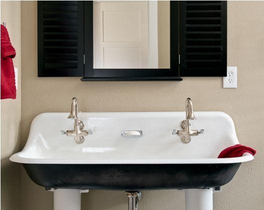 trough bathroom sink. Trough sink at New Urban Farmhouse in Orlando  interior design by Patricia Gaylor