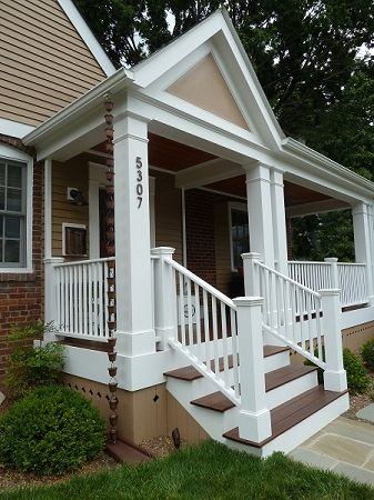Portico And Veranda With Wrap Around White Picket Railing