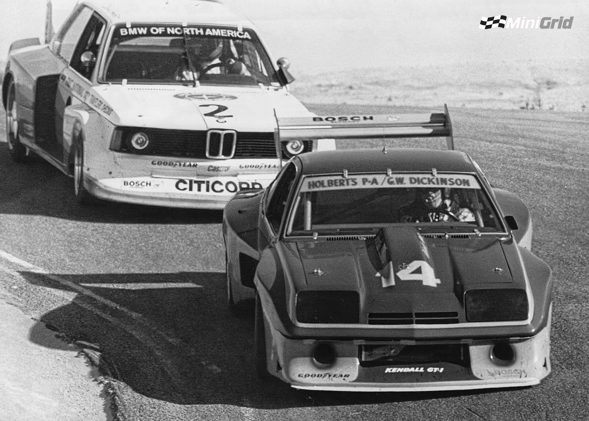 Al Holbert Plunges Down The Corkscrew At Laguna Seca In His Monza Chased Hard By The Bmw 320i Of David Hobbs In With Images Chevrolet Monza Sports Car Racing Nascar Racing