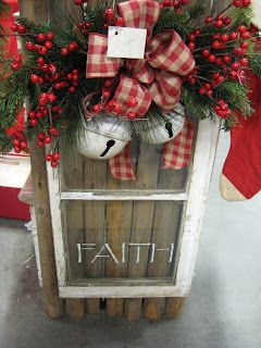 Old Window...with pine, jingle bells & berries. The old lawyer's bookcase glass fronts could work for this:)