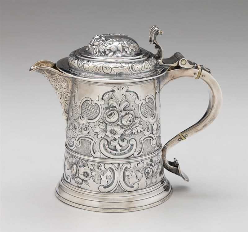 George I Britannia standard silver tankard Samuel Wastell, London, 1719-20 Cylindrical form repoussé-worked and incised with all over C-scrolls and flowerheads on a stippled ground, hinged cover with scrolling thumbpiece and gilt-washed interior,
