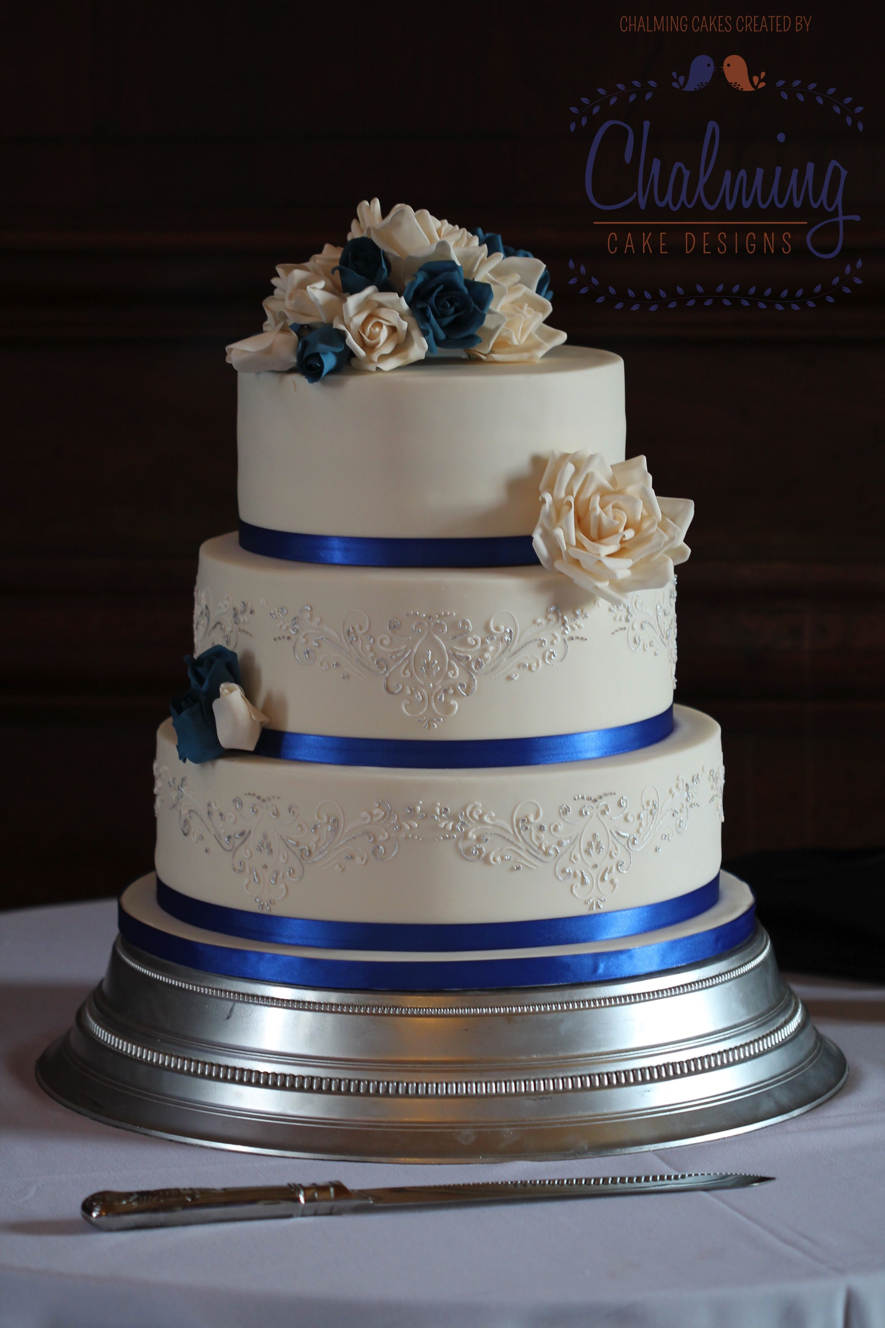 Royal Blue Ivory Silver Wedding Cake Ivory And Royal Blue Roses Silver Stencilling Just B Silver Wedding Cake Wedding Cakes Blue Royal Blue Wedding Cakes