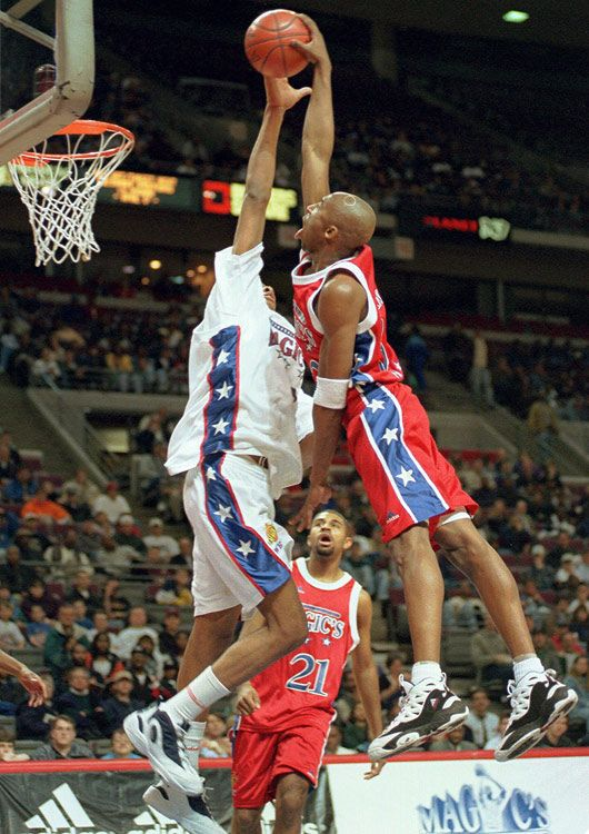 ba6c7fceb9f A member of the East team, Bryant shoots over the West team's Jamaal  Magloire during Magic's Roundball Classic at The Palace of Auburn Hills,  Mich., ...