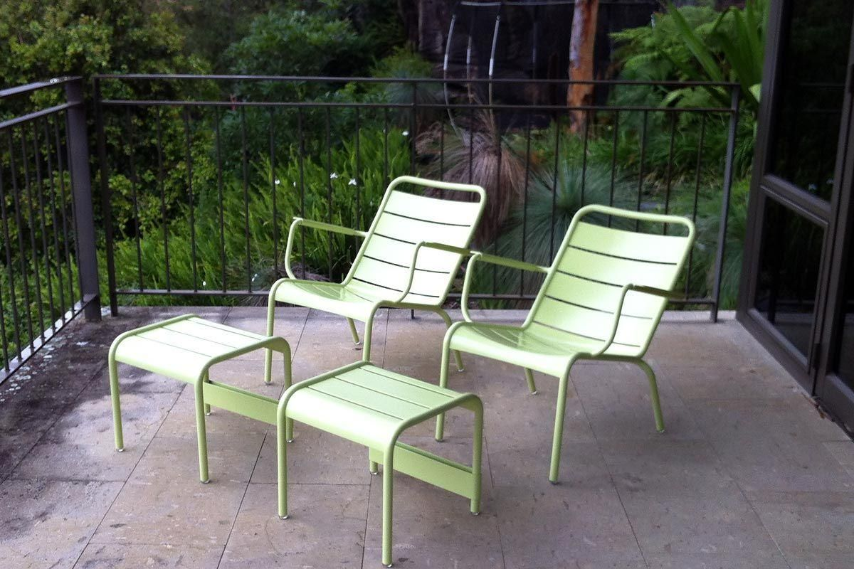 Relax in a pair of the legendary Luxembourg armchairs in willow green