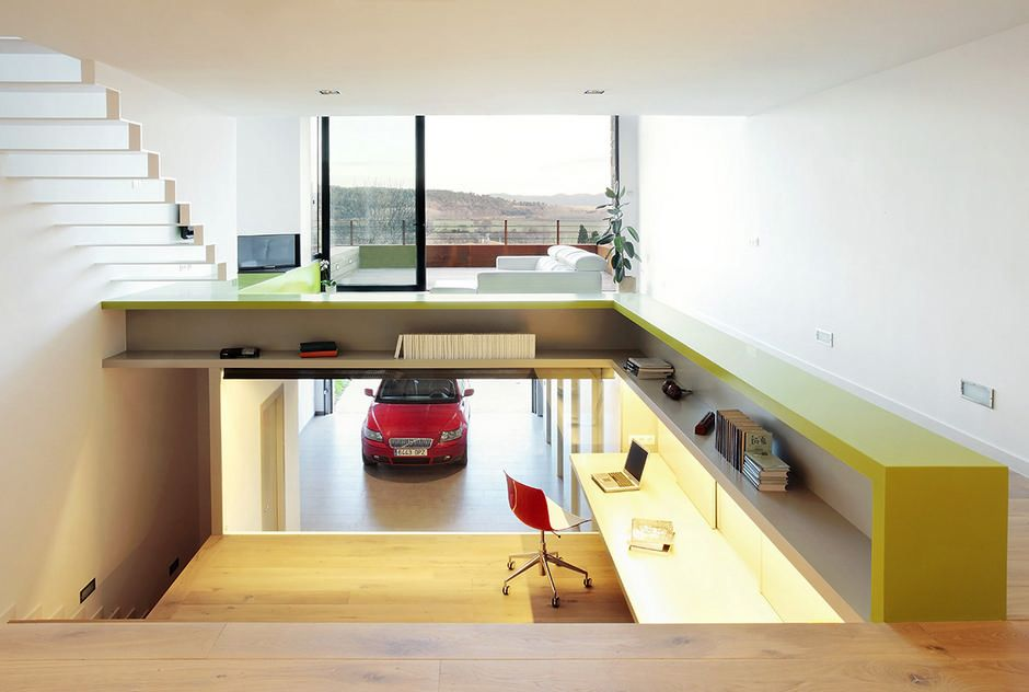Built by 05 am arquitectura in casavells spain with date images by josé hevia the house is located between party walls in a long and narrow plot in the