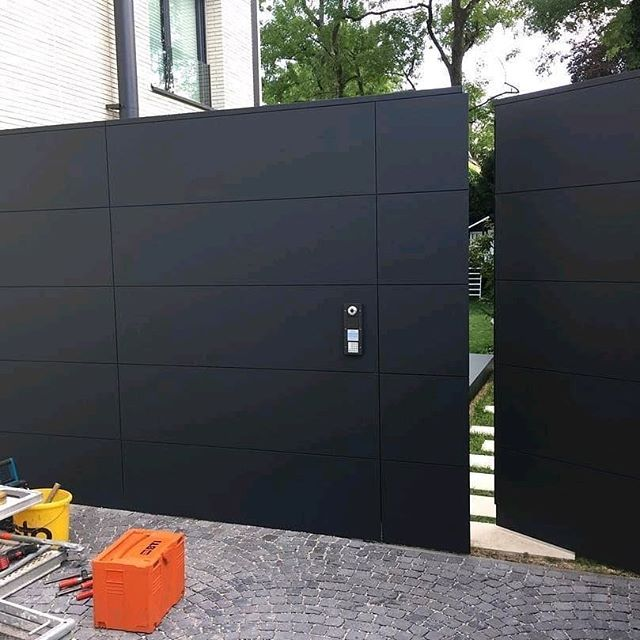 A facade cladding is created here with a flush door …