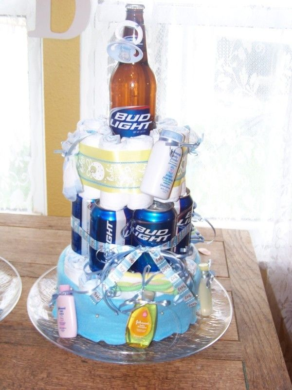 DIY beer diaper cake! I used 64 size 2 diapers and 12 cans. Super ...