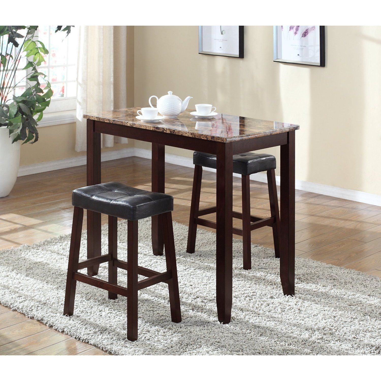 3 Piece Counter Height Table And Saddleback Stools With