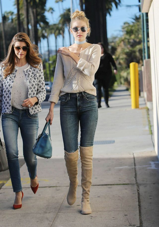 03bce72520c Take notes, trendsetters: Model Gigi Hadid's casual style is still  smoldering thanks to her flat over-the-knee boots, high-waist skinny jeans  and ivory ...