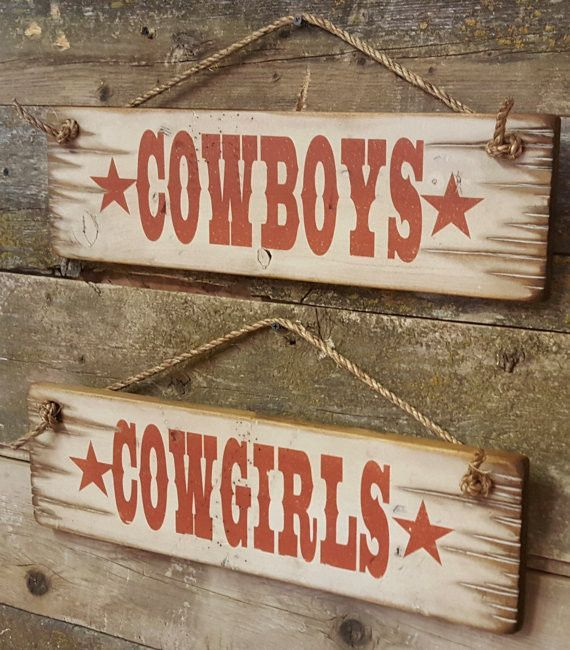 Cowboys and Cowgirls Set Set of Two Signs Antiqued Distressed Old West Sign Handcrafted with Pride in the West This set of wooden signs includes COWBOYS and COWGIRLS. So much nicer to use in your place of business than the typical plastic. Consider for your restroom doors, dressing rooms, apparel or accessory areas. - Handmade of pine and distressed to look weathered - Rustic Western signs with white background - Measures 19w x 1d x 5.5h - Handmade in the USA - Distressed finish may vary slig #cowboysandcowgirls