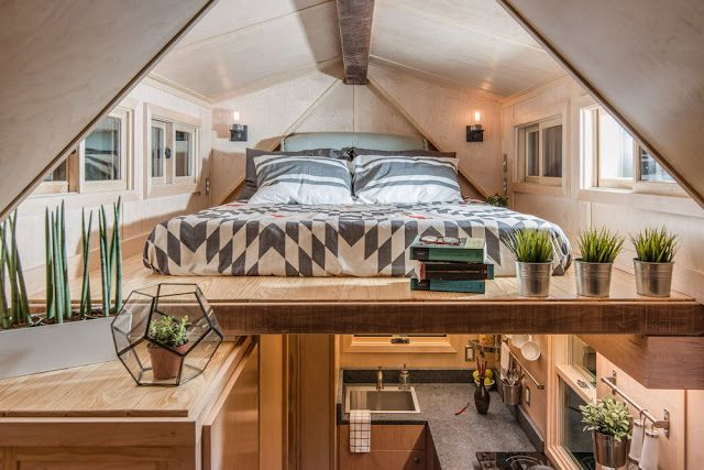 The loft bedroom of the Riverside house 246 sq ft tiny house on