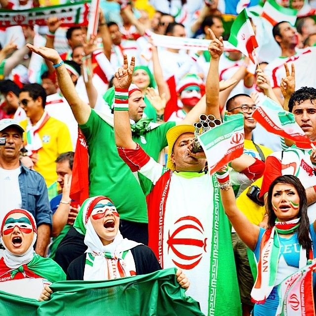 The Magic Of The Worldcup Is How It Brings Fans Together These Iran Fans Are Roaring On Their Team In Salvador Teamme Soccer World Iran Soccer Soccer Fans