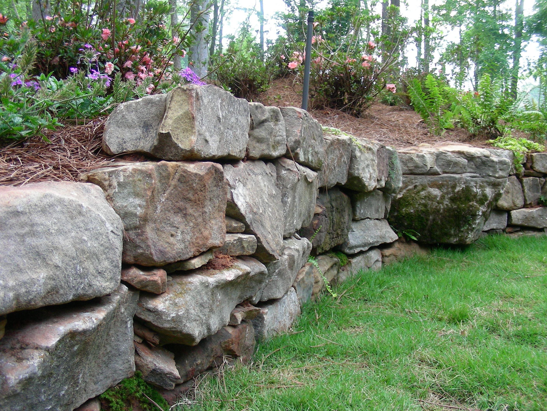boulder retaining wall man