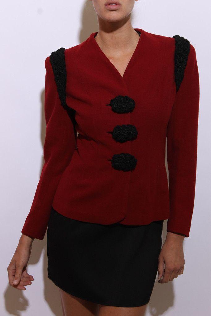 This vintage 1940s jacket is made of dark red wool, and features black lamb fur trim. #1940s #vintagejacket #btmvintage Shop now at: www.btmvintage.com