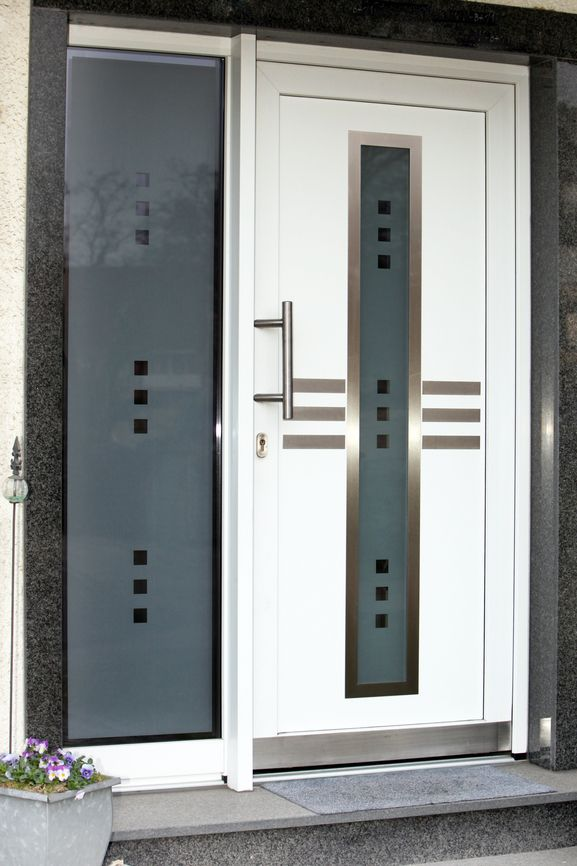 Modern Front Door With Silver Ornamentation And Glass Window