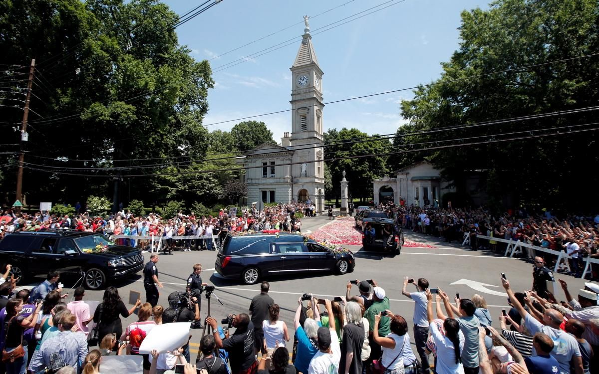 A hearse carrying the body of the late Muhammad Ali enters Cave Hill Cemetery in Louisville, Kentucky on June 10, 2016.