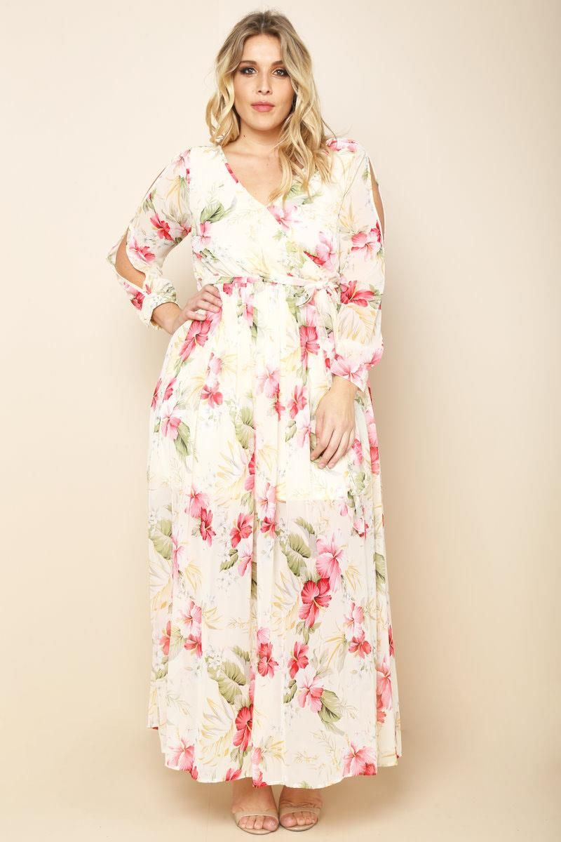 A plus size maxi dress with a wrapped V-neckline and long ...
