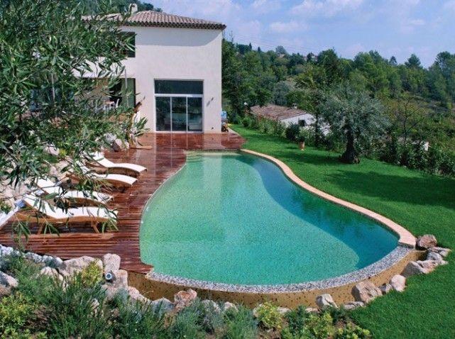 Une piscine pour tous les styles piscines couloir de nage et maison style for Piscine coque a debordement