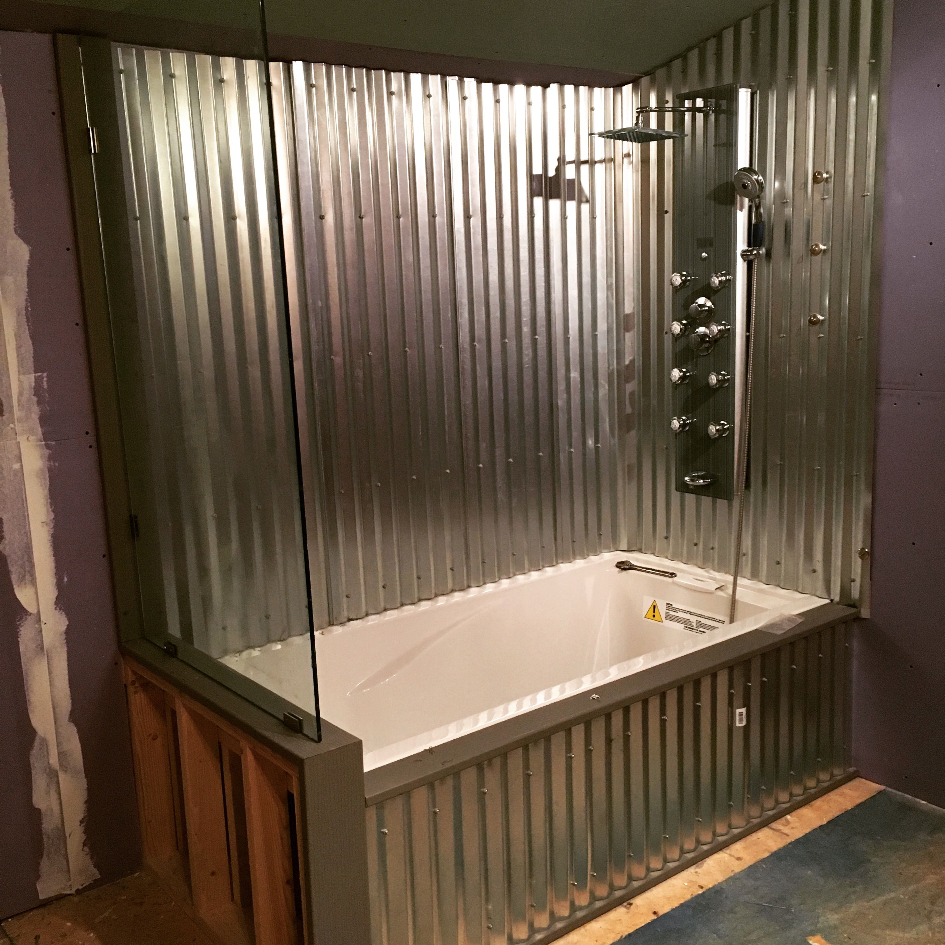 Drop In Tub With Corrugated Metal Surround And Glass Wall