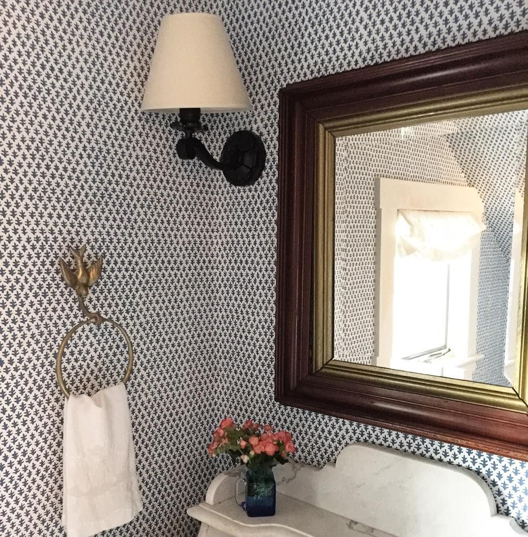 Charming powder room with Sister Parish Burmese Blue wallpaper - via James Showroom