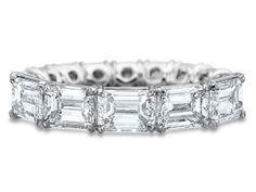 horizontal emerald cut diamond eternity band prong setting