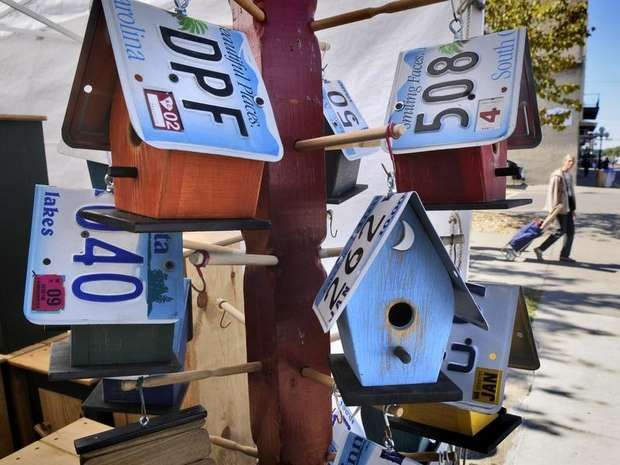 Re-purposed license plates became the roof for colorfully painted birdhouses at one booth Sunday at the Little Falls Arts & Crafts Fair.