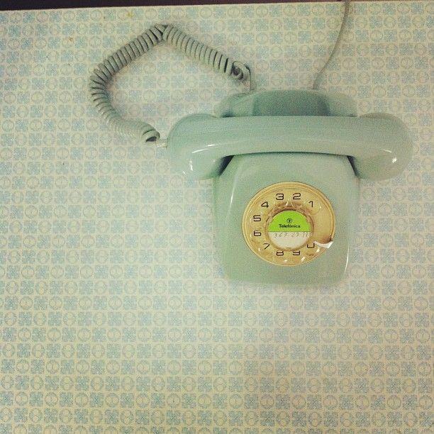 Vintage telephone in the kitchen Photo by Alvaro Sanz
