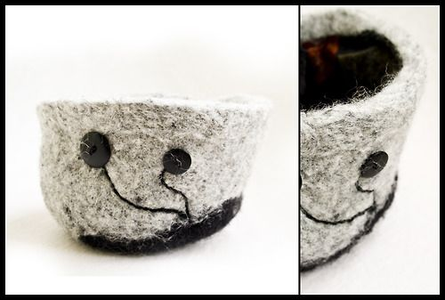 Felted bowl decorated with black buttons