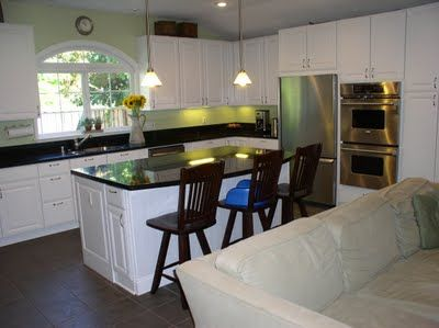 Kitchens With White Cabinets And Green Walls crisp white cabinets with black countertop and sage green walls