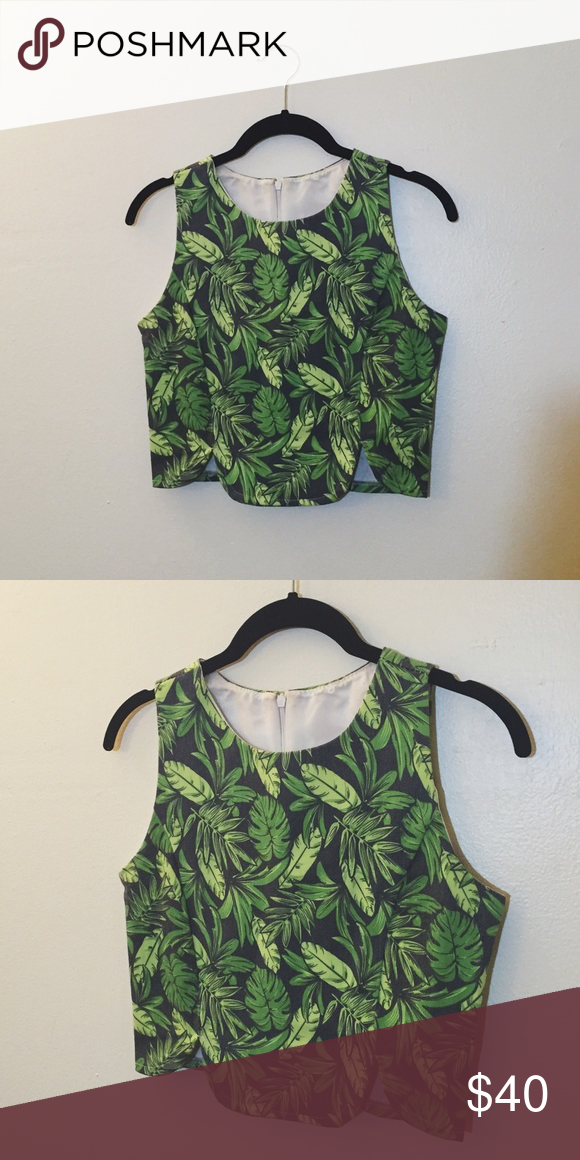 asymmetrical 🌴tropical 🌴 crop top green jungle leaves on a grey background. back has a zipper going 2/3 down. stretchy. lightly worn, light staining on interior🌴🌴offers welcome! Vintage Tops Crop Tops