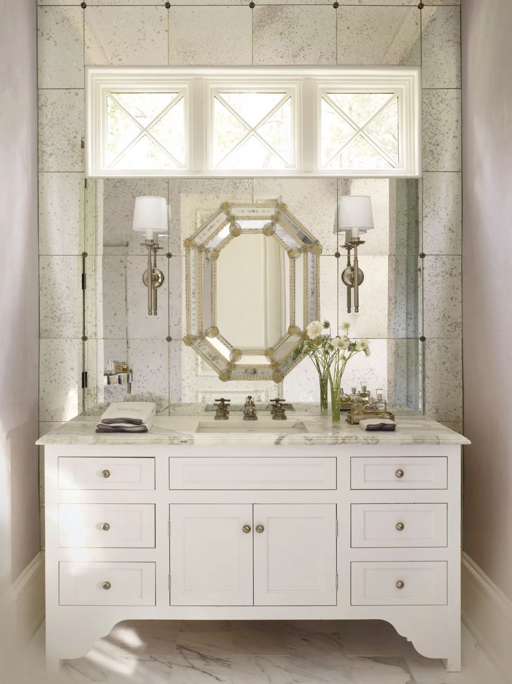 Beautiful bathroom design featuring stunning Venetian Murano glass mirror on  the background of antiqued mirrored wall. bathroom design with Venetian Murano glass mirror  Venetian