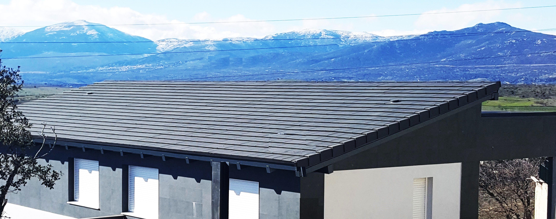 Teja plana en una de nuestras viviendas prefabricadas de - Viviendas de acero ...