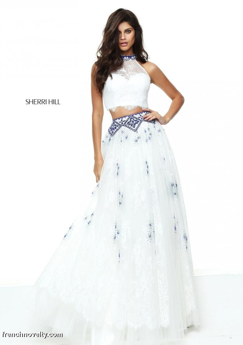 Sherri hill is a two piece prom gown with a sheer high neck