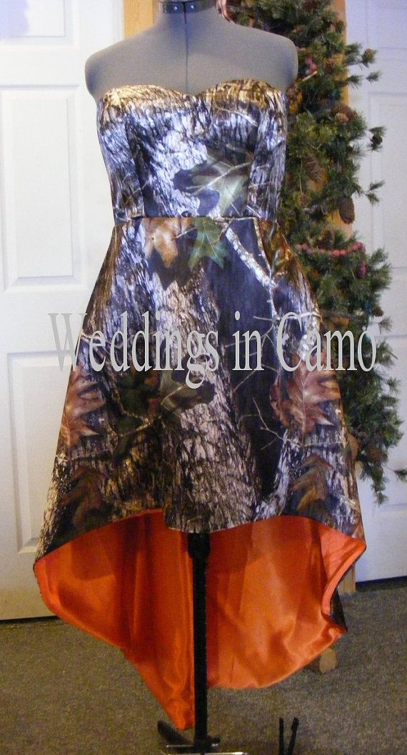 Good basic CAMO satin strapless dress. High low hemline CAMO shown in Mossy Oak and orange with corset back. Good for PROM (plus sizes available) starts at  $334.75 www.weddingsincamo.com