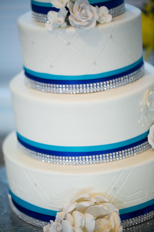 Hockey themed wedding cake. Hockey stick imprinted into buttercream ...